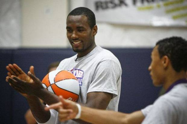 Serge Ibaka laughs during a drill at the Thunder Youth Basketball Camp at the Santa Fe Family Life Center on Tuesday, June 14, 2011. Photo by Zach Gray, The Oklahoman <strong>ZACH GRAY</strong>