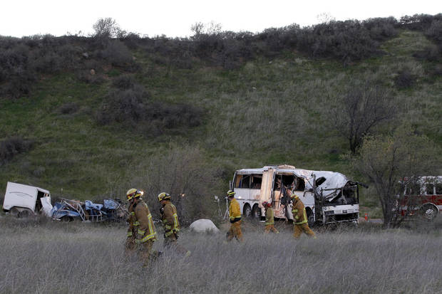 San Bernardino Fire Department  Investigators search through the brush Monday Feb. 4, 2013, at the scene of a tour bus accident that killed at least 8 Sunday evening in the mountains near San Bernardino, Calif.  ( AP Photo/Nick Ut)