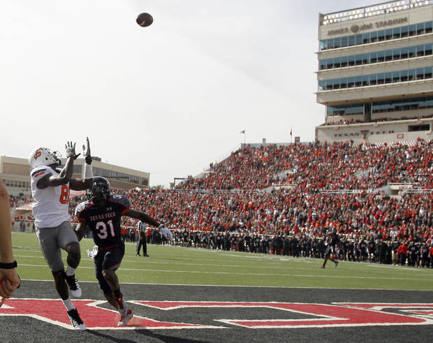 Oklahoma State Cowboys's Justin Blackmon (81) scores a touchdown as Eugene Neboh (31) defends him down during a college football game between Texas Tech University (TTU) and Oklahoma State University (OSU) at Jones AT&T Stadium in Lubbock, Texas, Saturday, Nov. 12, 2011.  Photo by Sarah Phipps, The Oklahoman  ORG XMIT: KOD