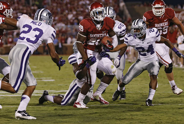 Oklahoma's Damien Williams (26) is stopped short of the goal line by the Kansas State defense during the college football game between the University of Oklahoma Sooners (OU) and the Kansas State University Wildcats (KSU) at the Gaylord Family-Memorial Stadium on Saturday, Sept. 22, 2012, in Norman, Okla. Photo by Chris Landsberger, The Oklahoman