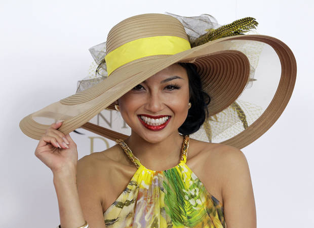 "Jeannie Mai , host of Style Network's ""How Do I Look?"" arrives the 138th Kentucky Derby horse race at Churchill Downs Saturday, May 5, 2012, in Louisville, Ky. (AP Photo/Darron Cummings)  ORG XMIT: DBY136"