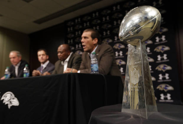 The Vince Lombardi Trophy sits alongside Baltimore Ravens president Dick Cass, from left, head coach John Harbaugh, general manager and executive vice president Ozzie Newsome and owner Steve Bisciotti as they speak at an NFL football news conference on Thursday, Feb. 7, 2013, in Owings Mills, Md. The Ravens beat the San Francisco 49ers 34-31 in Super Bowl XLVII last Sunday. (AP Photo/Patrick Semansky)
