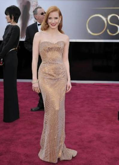 Jessica Chastain walks the Oscars red carpet (AP)