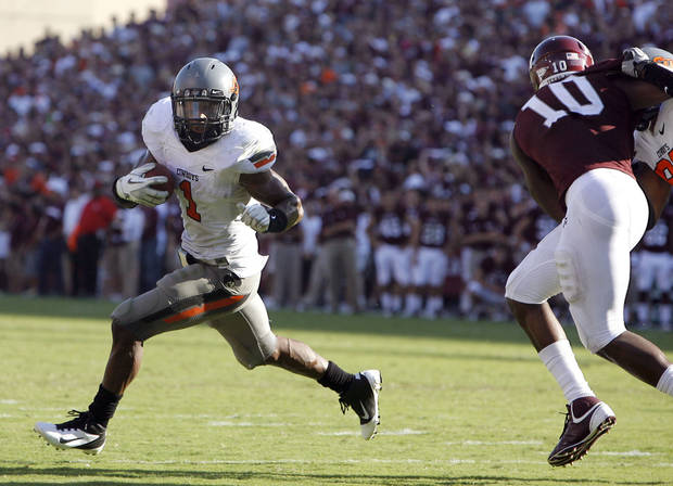 Oklahoma State &#039;s Joseph Randle gets by Texas A&amp;M &#039;s Sean Porter in the second half of the Cowboys win on Saturday in College Station, Texas. Photo by Sarah Phipps, The Oklahoman
