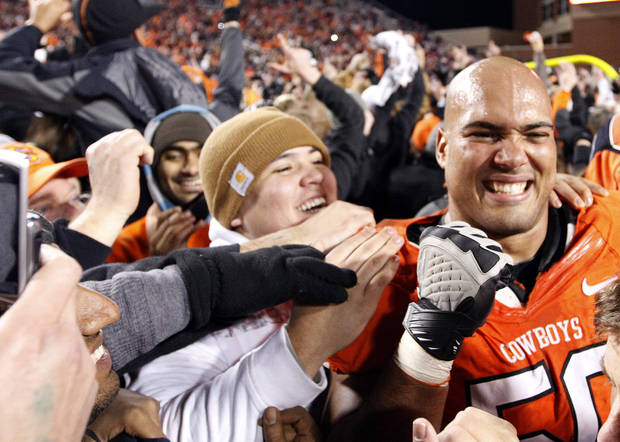 Oklahoma State's Jamie Blatnick (50) celebrates with fans during the Bedlam college football game between the Oklahoma State University Cowboys (OSU) and the University of Oklahoma Sooners (OU) at Boone Pickens Stadium in Stillwater, Okla., Saturday, Dec. 3, 2011. Photo by Sarah Phipps, The Oklahoman