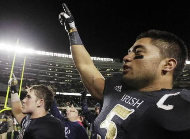 Notre Dame linebacker Manti Te'o (5) celebrates with teammates after they defeated Miami 41-3 in an NCAA college football game in Chicago, Saturday, Oct. 6, 2012. (AP Photo/Nam Y. Huh)