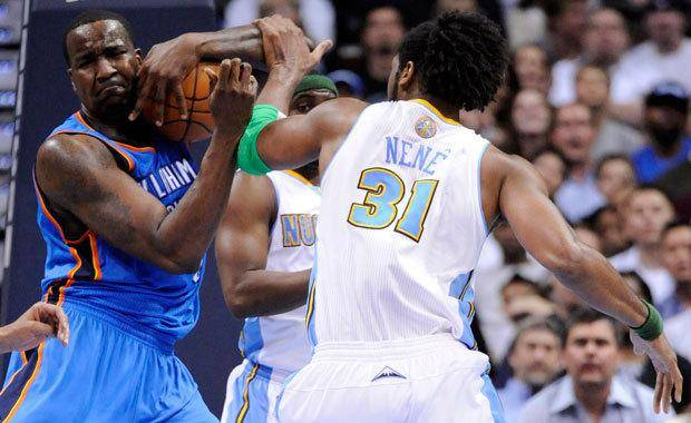Oklahoma City Thunder center Kendrick Perkins (5) and Denver Nuggets center Nene (31) from Brazil fight for posession during the second quarter of an NBA basketball game Tuesday, April 5, 2011, in Denver. the two were separated by teammates and referees (AP Photo/Jack Dempsey)