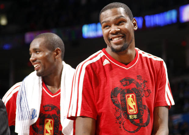 Oklahoma City's Kevin Durant (35) and Oklahoma City's' Serge Ibaka (9) laugh in the fourth quarter of the NBA game between the Oklahoma City Thunder and the Phoenix Suns at theChesapeake Energy Arena, Friday, Feb. 8, 2013.Photo by Sarah Phipps, The Oklahoman