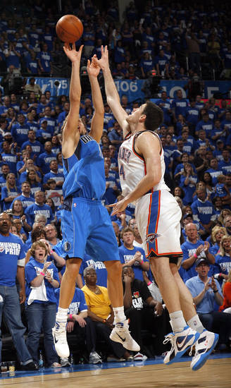 Dirk Nowitzki (41) of Dallas shoots over Oklahoma City's Nick Collison (4) during game 3 of the Western Conference Finals of the NBA basketball playoffs between the Dallas Mavericks and the Oklahoma City Thunder at the OKC Arena in downtown Oklahoma City, Saturday, May 21, 2011. Photo by Sarah Phipps, The Oklahoman