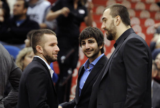 ADVANCE FOR WEEKEND EDITIONS, DEC. 8-9 - FILE - In this Nov. 14, 2012, file photo, injured Minnesota Timberwolves players, from left, J.J. Barea, Ricky Rubio of Spain, and Nikola Pekovic of Montenegro, chat before an NBA basketball game against the Charlotte Bobcats in Minneapolis. Thanks to a renewed focus overseas from David Kahn and top international scout Pete Philo, suddenly Minnesota is becoming a destination site for some of the top talent in the world.  (AP Photo/Jim Mone)