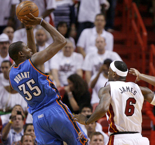 Oklahoma City&#039;s Kevin Durant (35) shoots the ball beside Miami&#039;s LeBron James (6) during Game 4 of the NBA Finals between the Oklahoma City Thunder and the Miami Heat at American Airlines Arena, Tuesday, June 19, 2012. Photo by Bryan Terry, The Oklahoman