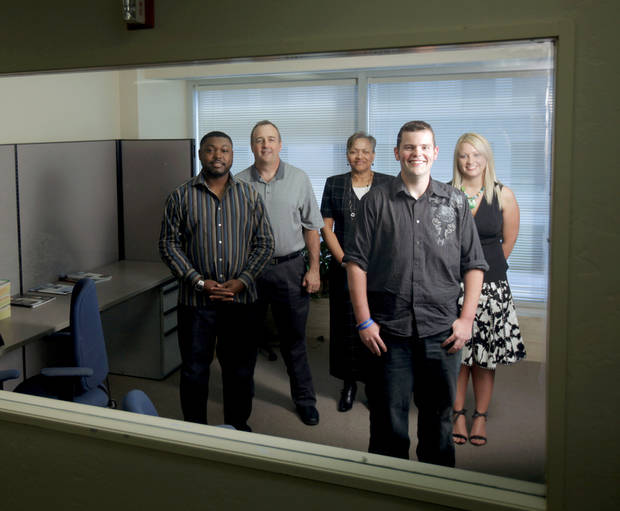 From left, Trevor Gadson, James Wright, Judi Smith, Joseph Coleman and Mindy Campbell pose recently at  Software Development Technologies.  PHOTO BY BRYAN TERRY,  THE OKLAHOMAN