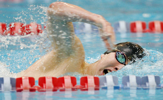 Typ Whinnery of Deer Creek swims in the boys 500-yard freestyle final on the way to first place during the Class 5A state high school swimming championship at the Oklahoma City Community College Aquatic Center in Oklahoma City, Saturday, February 20, 2010. Photo by Nate Billings, The Oklahoman