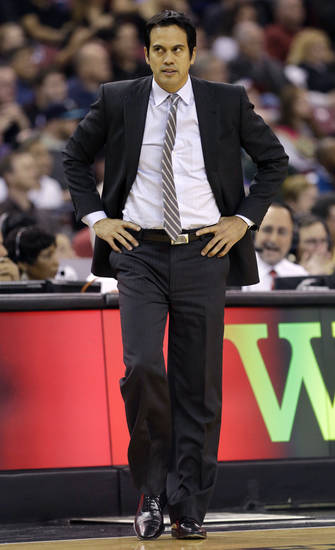 Miami Heat head coach Erik Spoelstra walks on the court during a timeout in the first quarter of an NBA basketball game against the Sacramento Kings in Sacramento, Calif., Saturday, Jan. 12, 2013. (AP Photo/Rich Pedroncelli)