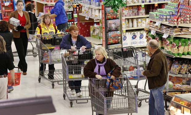 The threat of a severe winter storm, expected to arrive in Oklahoma City on Christmas Day,  sent hundreds of shoppers scurrying in the aisles at Crest Foods, 15th and Santa Fe in Edmond Monday, Dec. 24, 2012, Photo by Jim Beckel, The Oklahoman
