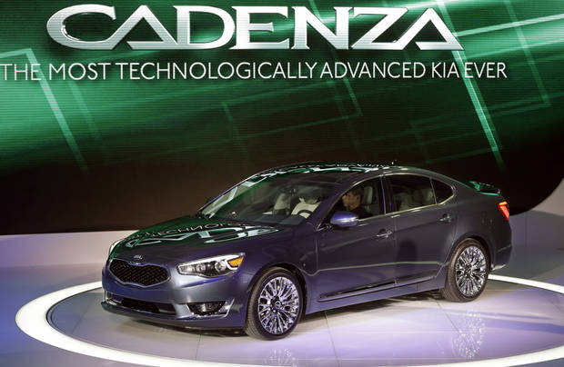 The Kia Cadenza is unveiled at the North American International Auto Show in Detroit, Tuesday, Jan. 15, 2013. (AP Photo/Carlos Osorio)