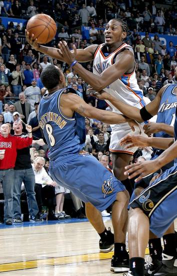 Oklahoma City's Kyle Weaver goes by Washington's Javaris Crittenton during the NBA basketball game between the Oklahoma City Thunder and the Washington Wizards at the Ford Center in Oklahoma City, Wed., March 4, 2009. PHOTO BY BRYAN TERRY, THE OKLAHOMAN