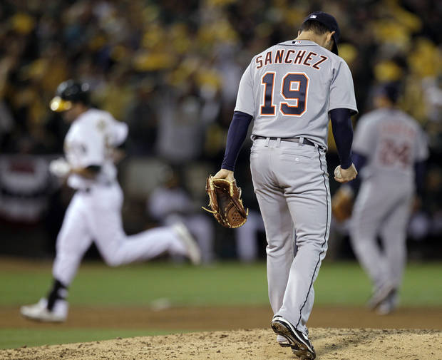 Detroit Tigers starting pitcher Anibal Sanchez hangs his head as Oakland Athletics' Seth Smith rounds the bases on a solo home run in the fifth inning of Game 3 of an American League division baseball series in Oakland, Calif., Tuesday, Oct. 9, 2012. (AP Photo/Ben Margot)