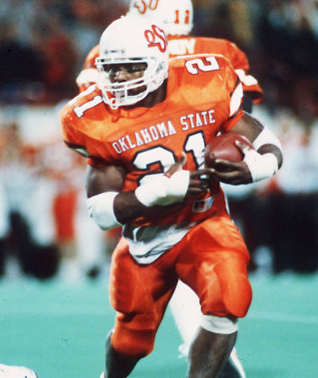 COWBOYS /  OKLAHOMA STATE UNIVERSITY, COLLEGE FOOTBALL, OSU: Barry Sanders won the 54th Heisman trophy in 1988. He rushed for 2,628 yards in his junior season and had four games for more than 300 yards. Staff photo.