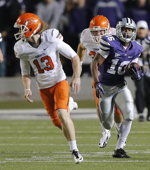 Kansas State's Tyler Lockett (16) runs past Oklahoma State's Quinn Sharp (13) on a kick return for a touchdown during the college football game between the Oklahoma State University Cowboys (OSU) and the Kansas State University Wildcats (KSU) at Bill Snyder Family Football Stadium on Saturday, Nov. 1, 2012, in Manhattan, Kan. Photo by Chris Landsberger, The Oklahoman