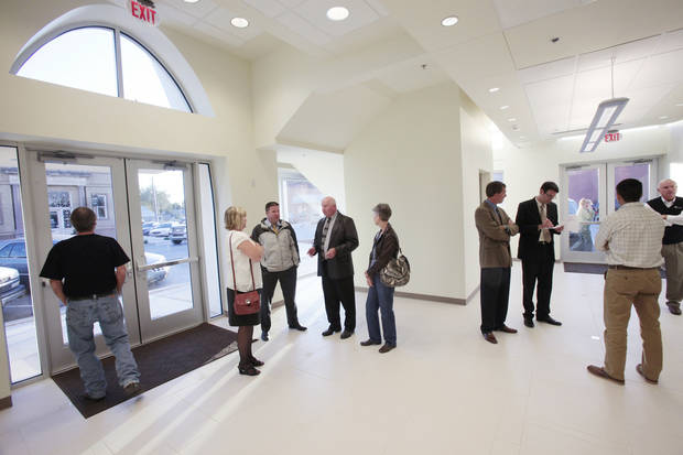Guests look over Tuttle�s new municipal building�s entryway. Photo By David McDaniel, The Oklahoman