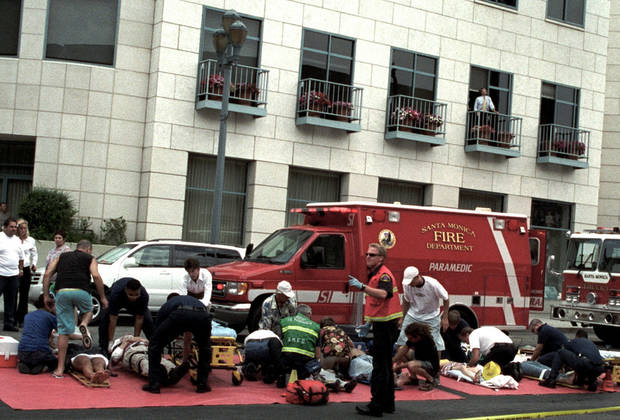FILE - This July 16, 2003, file photo shows emergency officials assisting injured pedestrians after a car plowed through a crowded farmers market in Santa Monica, Calif. Many motorists don&#039;t know it, but it&#039;s likely that every time they get behind the wheel there&#039;s a snitch along for the ride. In the next few days, the National Highway Traffic Safety Administration is expected to propose long-delayed regulations requiring auto manufacturers include event data recorders, better known as &quot;black boxes,&quot; in all new cars and light trucks. The NTSB has been pushing for recorders in all passenger vehicles since the board&#039;s investigation of the 2003 accident in which an elderly driver plowed through an open-air market in Santa Monica. Ten people were killed and 63 others injured. The driver refused to be interviewed and his 1992 Buick LeSabre didn&#039;t have a recorder. (AP Photo/Nate Rawner, File)