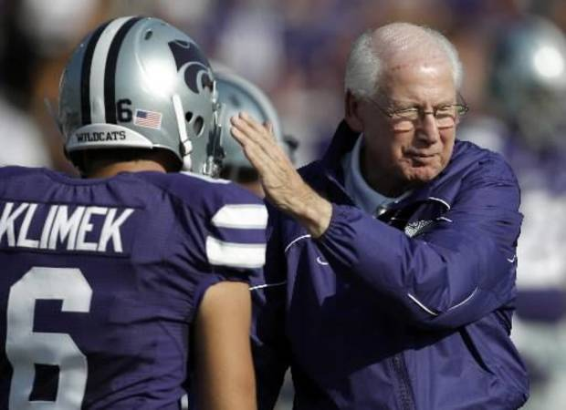 In this photo taken Saturday, Sept. 1, 2012, Kansas State coach Bill Snyder pats the helmet of place kicker Brandon Klimek (6) before a game against Missouri State in Manhattan, Kan. (AP Photo/Orlin Wagner