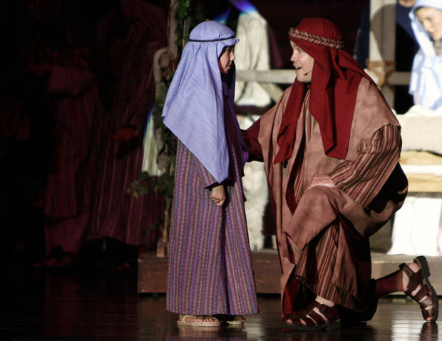 Justin Attebery, right, playing Joseph, performs with a young boy during a  2006 dress rehearsal for the play &quot;One Incredible Moment&quot; at First Presbyterian Church of Edmond. Attebery will reprise the role of Joseph in this year&#039;s production at the church. Oklahoman Archive Photo 