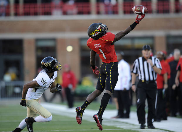 Maryland wide receiver Stefon Diggs (1) reaches for a pass, that went incomplete, against Wake Forest cornerback Kevin Johnson, left, during the second half of an NCAA football game, Saturday, Oct. 6, 2012, in College Park, Md. Maryland won 19-14. (AP Photo/Nick Wass)