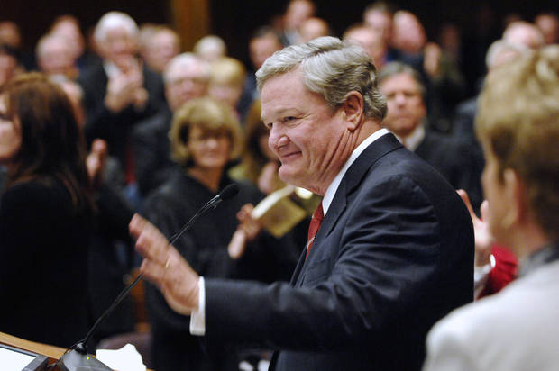 North Dakota Gov. Jack Dalrymple waves to the crowd before delivering the State of the State Address at the Capitol in Bismarck, N.D. on Tuesday Jan. 8, 2013.  (AP Photo/Will Kincaid)