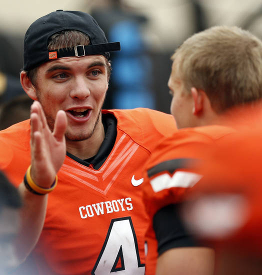 OSU quarterback J.W. Walsh (4) talks with Blake Webb (85) on the sideline in the fourth quarter during a college football game between Oklahoma State University (OSU) and the University of Louisiana-Lafayette (ULL) at Boone Pickens Stadium in Stillwater, Okla., Saturday, Sept. 15, 2012. OSU won, 65-24. Photo by Nate Billings, The Oklahoman