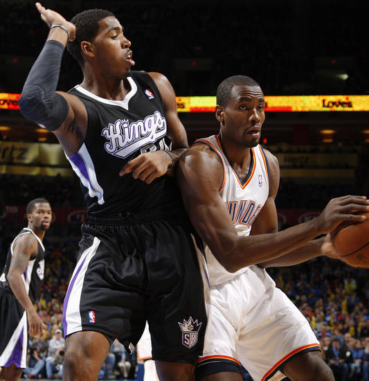 Oklahoma City&#039;s Serge Ibaka (9) tries to get around Sacramento&#039;s Jason Thompson (34)  during an NBA basketball game between the Oklahoma City Thunder and the Sacramento Kings at Chesapeake Energy Arena in Oklahoma City, Friday, Dec. 14, 2012. Photo by Bryan Terry, The Oklahoman