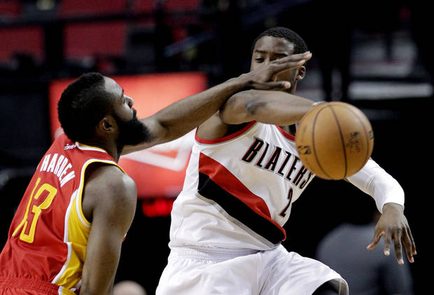 Houston Rockets guard James Harden, left, plays tight defense on Portland Trail Blazers guard Wesley Matthews during the first quarter of an NBA basketball game in Portland, Ore., Friday, April 5, 2013. (AP Photo/Don Ryan)