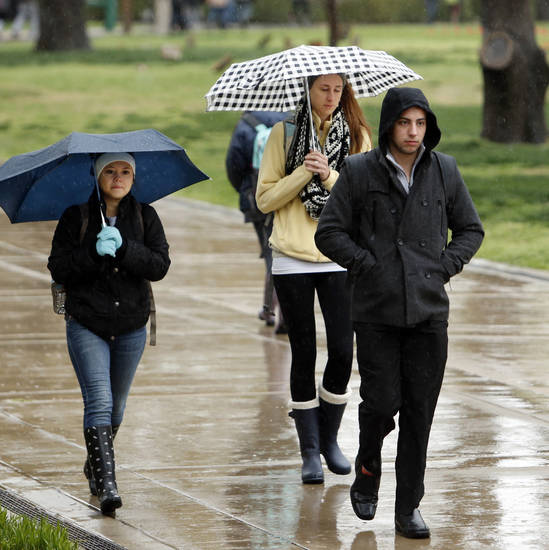 Students walk to class in the rain at the University of Oklahoma on Wednesday, April 10, 2013, in Norman, Okla.  Photo by Steve Sisney, The Oklahoman