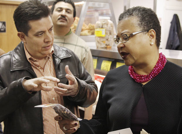 Francisco Ibarra, CEO, background, watches asTulsa manager Manuel Gomez, left, talksd about spices with Small Business Administration Deputy Administrator Marie Johns while touring Supermercados Morelos in Oklahoma City, November 30, 2011. Photo by Doug Hoke, The Oklahoman