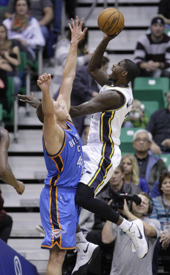 Utah Jazz forward Marvin Williams (2) shoots as Oklahoma City Thunder center Cole Aldrich (45) defends in the first quarter of a preseason NBA basketball game, Friday, Oct. 12, 2012, in Salt Lake City. (AP Photo/Rick Bowmer) ORG XMIT: UTRB106