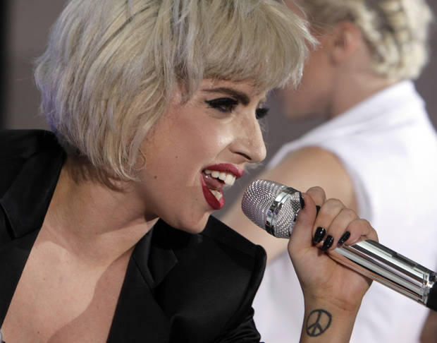 "Lady Gaga performs on the NBC ""Today"" television program in New York Friday, July 9, 2010. (AP Photo/Richard Drew) ORG XMIT: NYRD113"