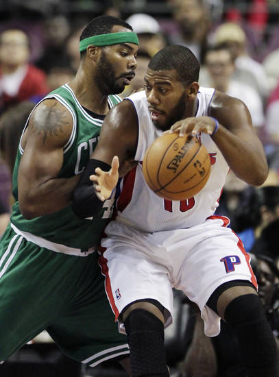 Detroit Pistons center Greg Monroe, right, drives against Boston Celtics forward Chris Wilcox in the first half of an NBA basketball game on Sunday, Nov. 18, 2012, in Auburn Hills, Mich. Monroe led the Pistons with 20 points and 13 rebounds in a 103-83 win. (AP Photo/Duane Burleson)