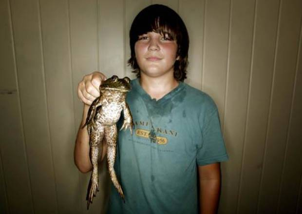 Colby Moates poses with his bull frog after the frog and turtle races, Wednesday, June 24, 2009, at  Camp DaKaNi in Oklahoma City. Photo by Sarah Phipps, The Oklahoman