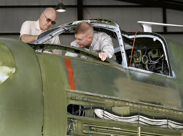 Kurt Konrath, left, and Scott Perkins in the cockpit of the A-26. Konrath is the group's crew chief. Perkins is chief pilot. A group of men are restoring the bomber inside a hangar at Guthrie Municipal Airport.   Photo by Jim Beckel, The Oklahoman <strong>Jim Beckel - THE OKLAHOMAN</strong>