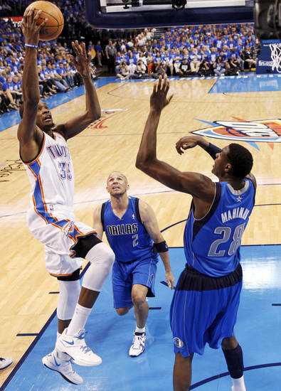 Oklahoma City's Kevin Durant (35) shoots against Dallas' Ian Mahinmi (28) and Jason Kidd (2) during game one of the first round in the NBA playoffs between the Oklahoma City Thunder and the Dallas Mavericks at Chesapeake Energy Arena in Oklahoma City, Saturday, April 28, 2012. Oklahoma City won, 99-98. Photo by Nate Billings, The Oklahoman