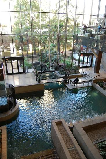 The lobby of the Hyatt Regency San Antonio features the San Antonio River flowing through the building. Photo by Annette Price, for The Oklahoman. <strong></strong>