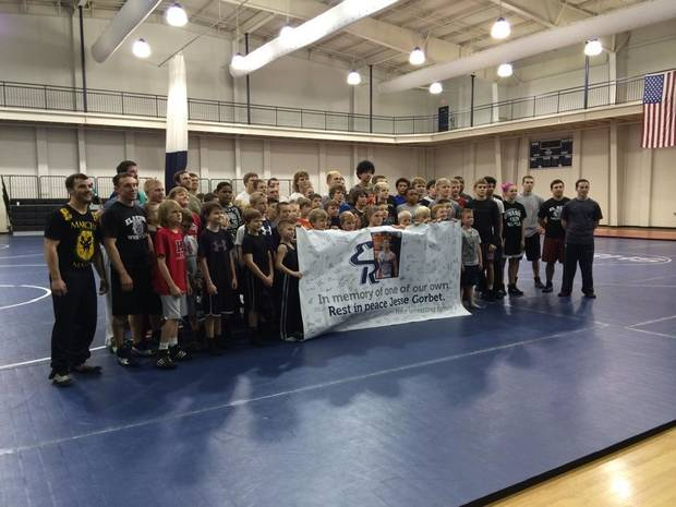 A group photo from Saturday's free wrestling clinic at Jenks Simmons Fieldhouse honoring Jesse Gorbet, a former El Reno wrestler who died in a car accident on March 2.