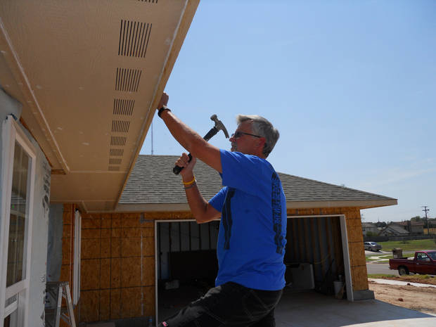 Gary Farnum works on a house for Central Oklahoma Habitat for Humanity. Farnum volunteers two days a week. <strong> - Provided</strong>
