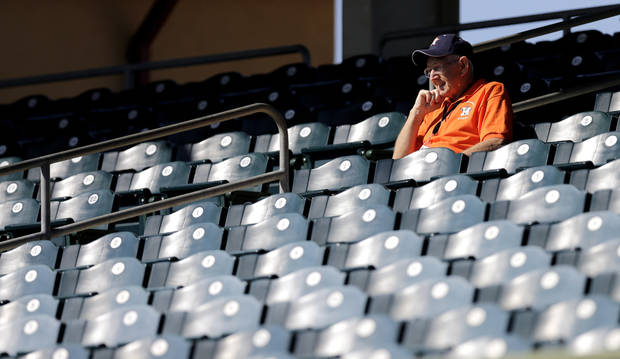 Usher Ed Zibrant watches the Houston Astros batting practice before an exhibition spring training baseball game against the New York Yankees Thursday, Feb. 28, 2013, in Kissimmee, Fla. (AP Photo/David J. Phillip)