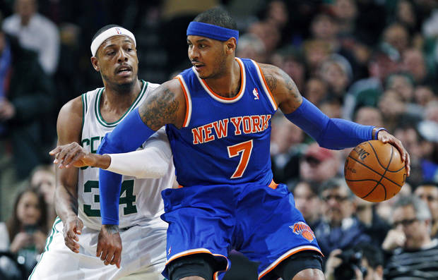 New York Knicks forward Carmelo Anthony (7) backs down on Boston Celtics forward Paul Pierce, left, during the first quarter of an NBA basketball game in Boston, Thursday, Jan. 24, 2013. (AP Photo/Charles Krupa)