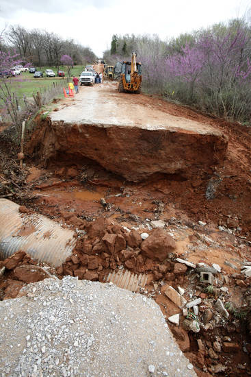 This bridge washed out on SE 125th in Oklahoma City, OK, removing the only means of exit for residents west of the bridge, Tuesday, March 20, 2012. The area is about a mile west of Harrah-Newalla Road.  By Paul Hellstern, The Oklahoman
