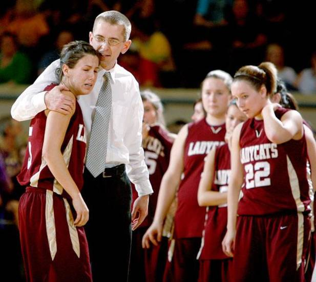 Cashion coach Chad Tichenor consoles Alycia Cavazos during the Class A girls basketball state tournament semifinal game between Preston and Cashion  at the State Fair Arena in Oklahoma City, Friday, March 6, 2009. PHOTO BY BRYAN TERRY, THE OKLAHOMAN