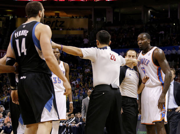 Oklahoma City's Kendrick Perkins (5) argues with Minnesota's Nikola Pekovic (14) during an NBA basketball game between the Oklahoma City Thunder and the Minnesota Timberwolves at Chesapeake Energy Arena in Oklahoma City, Wednesday, Jan. 9, 2013.  Photo by Bryan Terry, The Oklahoman