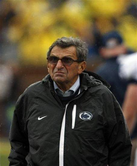 Penn State head coach Joe Paterno looks up at the scoreboard on the sidelines in the second quarter of an NCAA college football game with Michigan, Saturday, Oct. 24, 2009, in Ann Arbor, Mich. Penn State won 35-10. (AP Photo/Tony Ding)